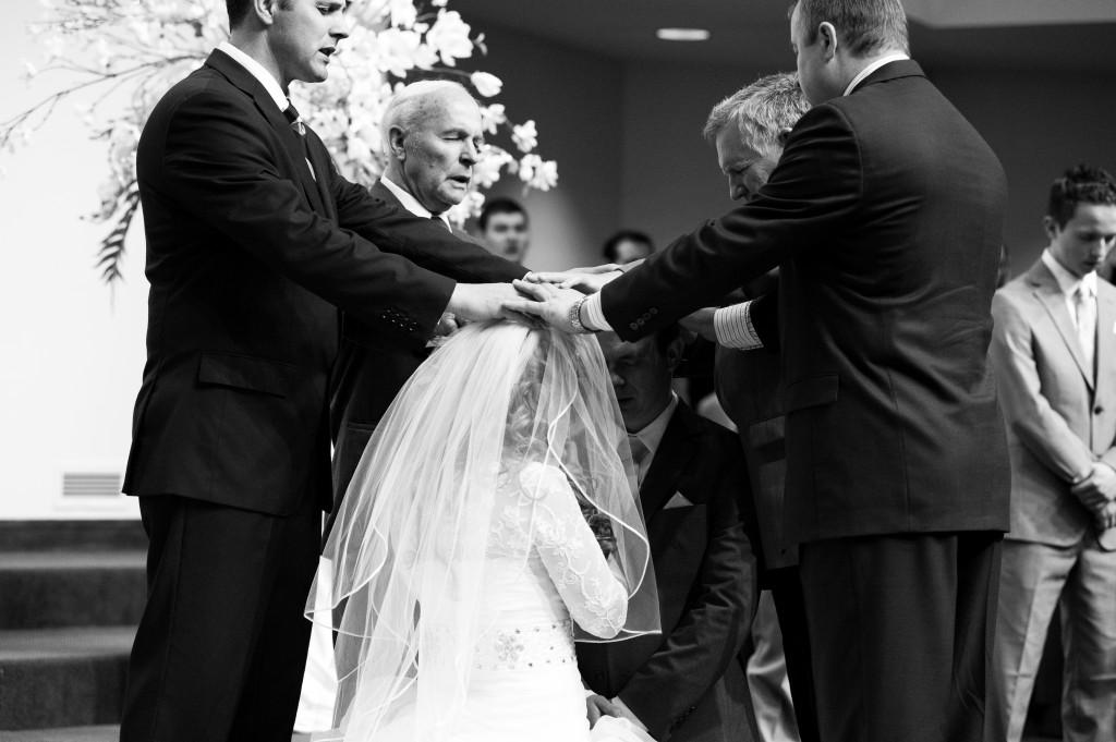 Pastors praying over bride and groom